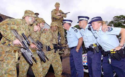 9RQR Captain Jason Stott looks over challenging Relay for Life participants Private Sam McElligott, Private Jamie McElligott and Private John Davis from 9RQR and Senior Sergeant Tony Cole, Constable Matt Walker and Senior Constable Kym Lynch from Maryborough Police.