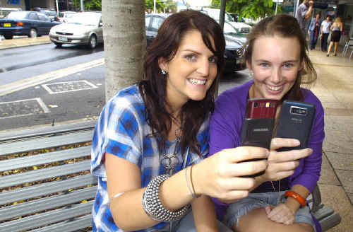 Maddie Orchard from East Ballina, and Katie Cross from East Lismore, admit to using their mobile phones while driving even though they know it's dangerous.