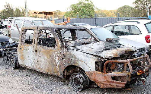 Two vehicles were destroyed by fire during a riot in Yamba on February 14.