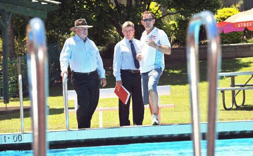 Scott Hunt (right) shows Cr Keith Rhoades and Council GM Stephen Sawtell around Woolgoolga Pool.