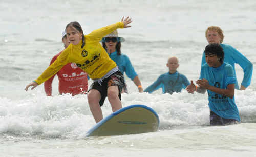 Sarah Hure of Grafton having a great time at the Hands on Surfing Day.