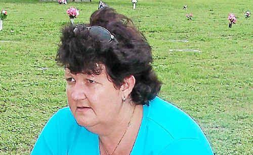 Karen West at her mother's grave in Eden Gardens.