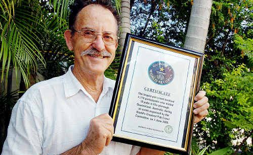John Meyers holds the certificate that confirms Maryborough is again the Guinness World Record holder of the largest pub crawl.