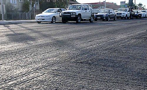 The Department of Main Roads and Transport is looking into the cause of deep grooves in recent highway work.