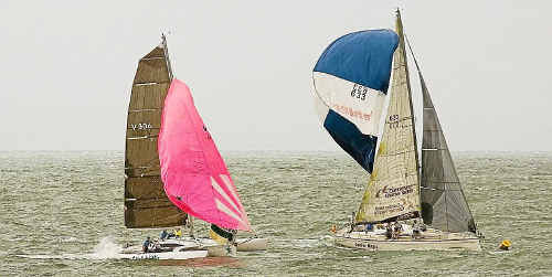 Tight racing as Slick Willie (Eric Smith) and Dehler Magic (Greg Tobin) hold their spinnakers to the last second before rounding a mark on Sunday.