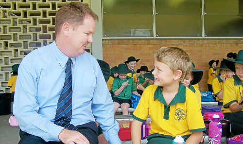 St Mary's principal John O'Connor with seven-year-old Travis Sage, who could be starting high school in four years instead of five.