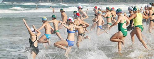 Competitors hit the water in last weekend's Queensland Surf Rescue Championships at Dicky Beach.