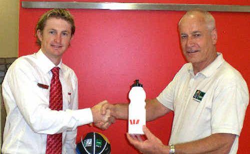 Westpac Coffs Harbour manager Michael Crossland with FIBA Oceania's Steve Smith.