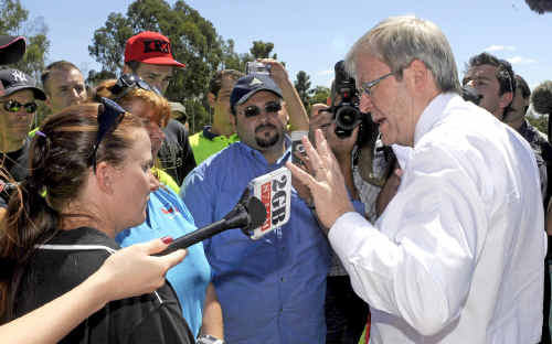 FACING THE MUSIC: Prime Minister Kevin Rudd speaking with protesting insulation installers in Canberra yesterday, including the general manager of the South Grafton-based company Power Results, Jo Doran, second from left. AAP IMAGE/ALAN PORRITT
