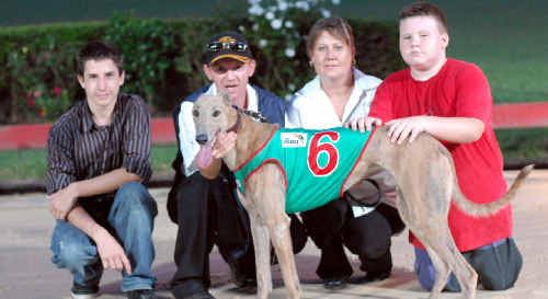 TRAINER Robbie Andrews and family with the winner.
