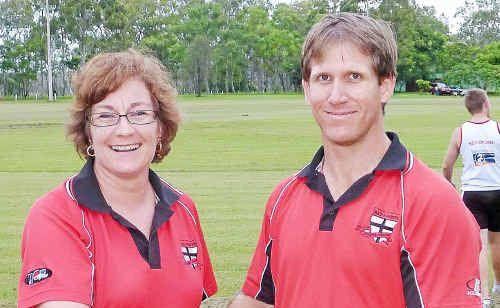 BITS Saints club president Judy Mountjoy congratulates club stalwart and new A-Grade coach Adam Dickenson.