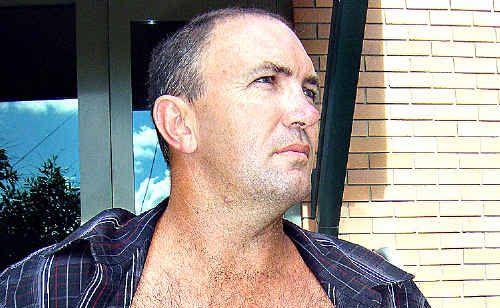 Stabbed: Sean Keidge shows a large scar down his abdomen.