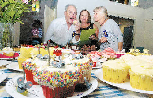 Judges (from left) Keith Pyke and Ellen Corrall, of Bangalow, and Stephanie King, of Eureka, take a break from their duties to indulge in some home-cooked delights.