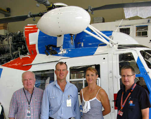 HELP IN RETURN: AGL Rescue Helicopter chairman Don Moffat, Deputy Mayor Tony Perrett, Michelle Perrett and CEO Rob Walford, with one of the rescue service's new aircraft.