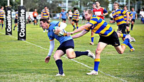 Sunshine Coast Stingray Adam Gavergan skips around the Townsville defence to score one of his two tries last night.