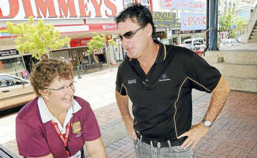Brad Solomon hands over some money for a new swing to Vicki Smyth.
