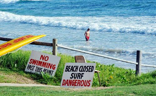 Surf Lifesavers placed warning sings on every beach up and down the NSW coast yesterday, similar to those here at Woolgoolga.