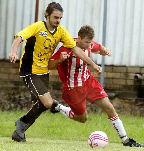 Goonellabah's Mitchell Edwards (left) and Lismore Workers' Corey Loft vie for possession in the Corey New Cup game at Weston Park, Goonellabah, on Saturday.