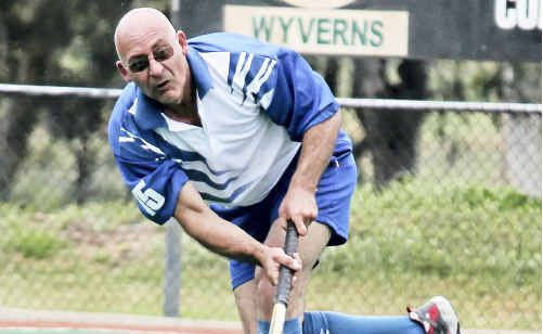 Wayne Bishop shows his style in hockey sevens yesterday.