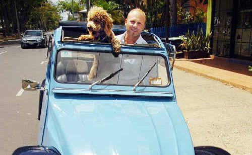 Hervey Bay's Paolo Esposito with his constant companion Ciro and his beloved car, the Citroen 2CV.