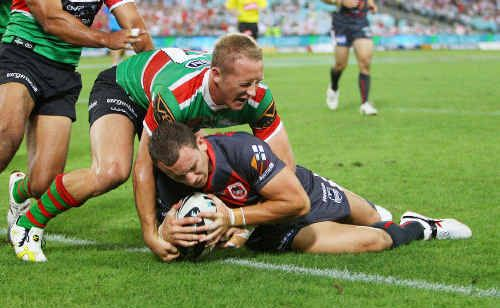 Former Hervey Bay Seagulls representative Nick Emmett crashes over to score a try for St George Illawarra Dragons during the NRL Charity Shield match against the South Sydney Rabbitohs at ANZ Stadium.
