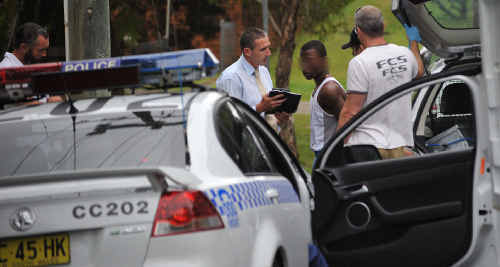 Detectives interview the suspect yesterday in Nariah Crescent.