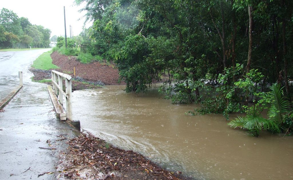 Flooding on the Sunshine Coast. Cooroora Creek bridge on Exhibition Street, Pomona was close to being submerged by surging flood waters.