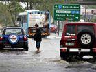 Downpour disrupts roads, flights