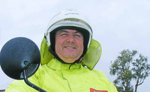 Australia Post postal delivery officer Michael Harrison copped a splashing yesterday.
