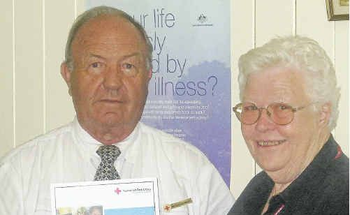 Red Cross Warwick Branch president for 10 years, Peter Stewart, was presented with an Australian Red Cross Service Award by Red Cross Queensland deputy chairwoman Win Smith.