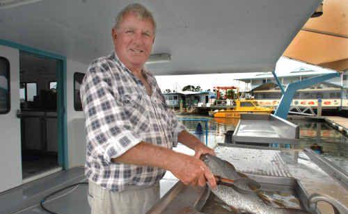 Yamba fishmonger Burr McPherson, of Burr's Seafood, in his new location at the Yamba Marina.