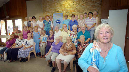 Current president of the Catholic Women's Group, Mary Roberts, with some of the members celebrating their 60th anniversary.