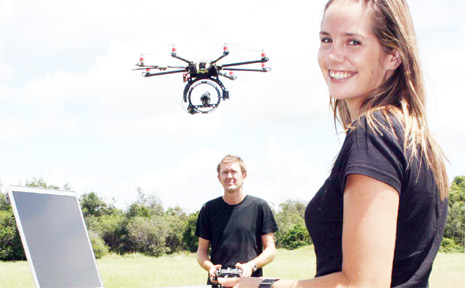 It's not a UFO . . . it's an 'octocopter'. At the controls is Simon Jardine and at the computer is Felicity Durham.
