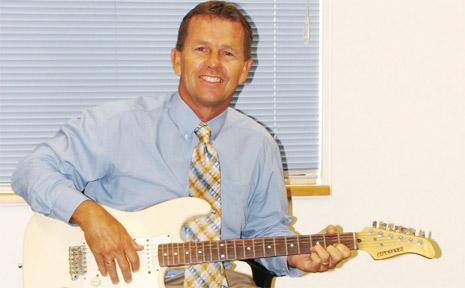 New principal of St John's Catholic School in Mullumbimby Tim Bleakley is a keen guitarist.