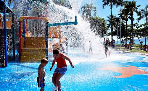 Children play in the sunshine on The Strand on Townsville's waterfront.