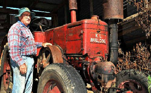 COLLECTOR: Doug Hoschke with his massive Bulldog tractor.
