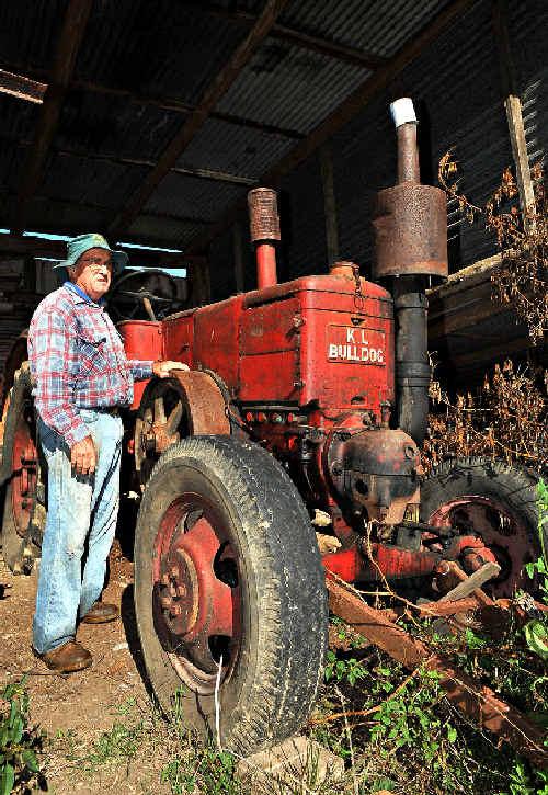 COLLECTOR: Doug Hoschke with his massive Bulldog tractor.