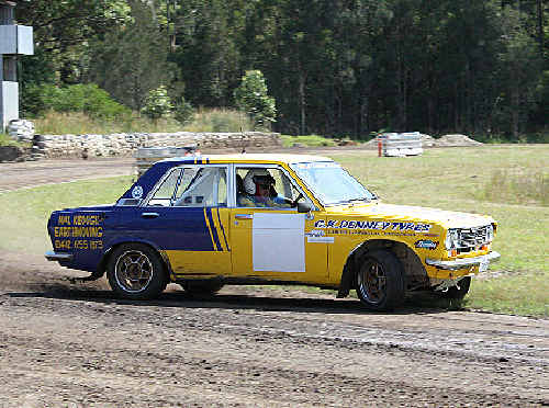 Mal Keogh in his Datsun 1600 at the flat track.