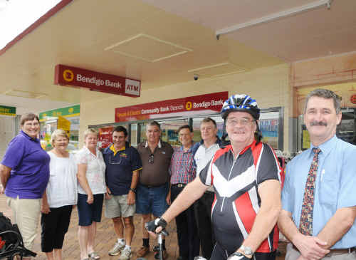 RIDING FOR A CUASE: Colin Turner and Mike McCarthy, Manager of the Bendigo Bank, along with with SCIC memebers in the background.