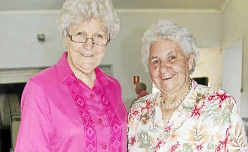 Wesley Uniting Church Indoor Bowls Club president Marg Wilkie with new life member Mabel Mott.