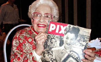 SADLY MISSED: Adelie with a photograph of herself and her camera on the cover of Pix magazine.