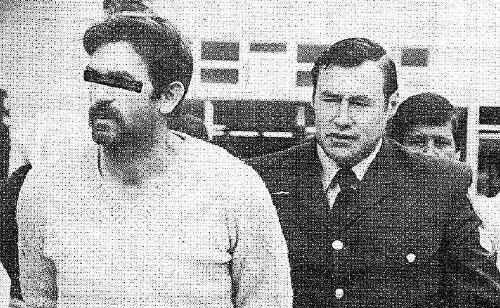 Robin Reid being led into Murwillumbah Court by Sergeant Kevin Welsh on Wednesday, August 11, 1982.