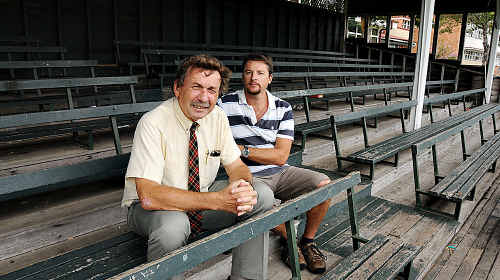 Gympie State High principal Murray Wegner (left) and acting head of science Eric Syme are looking to the future, but hoping some one will want to relocate the school's historic grandstand, which has to go to make way for a new science and language centre.