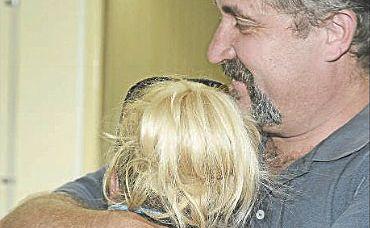Jessica's dad, Shayne Parfrey, consoles his daughter in Gladstone.