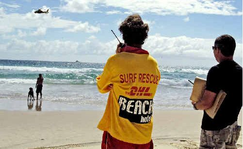 Surf Rescue crew, police, and the Westpac Rescue Helicopter combing Belongil Beach yesterday.