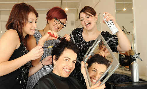 Apprentice hairdressers Kayla Lamont (left), 16, of Ballina, Chloe Hill, 20, of Byron Bay, and Sarah Kemp, 19, of Lennox Head, give their boss Sally Clarke (front) the royal treatment at Headroom in Ballina.