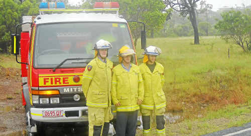 Agnes Water Auxiliary Fire Brigade captain Ian Birbeck (centre) with acting lieutenant Luke Cunningham and firefighter Jane Turner at the sight of the new station.