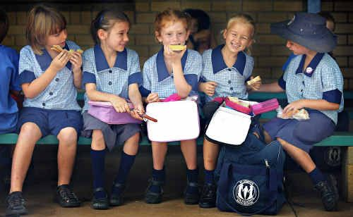 Hanna Tait (centre) used to dislike sandwiches for lunch because the bread always made her feel 'yukky' afterwards. Now she tucks into her midday meal along with her friends at school (from left) Kayley Murray, Melissa Meier, Charleze Girlder and Dakota Tomlinson.