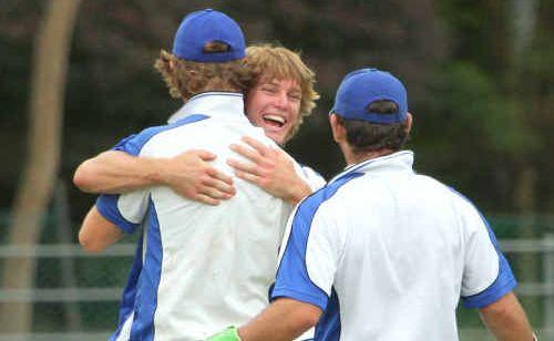 Happy with another wicket, Tucabia Blue fielders gather around Josh Gorman.