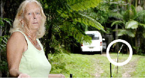 INNER Pocket resident Kath Vail stands beside an electric boundary fence which appears to block access to her property. However, the circled portion of the photo shows an isolator handle which allows access through the fence, according to neighbour Kelvin Daley.